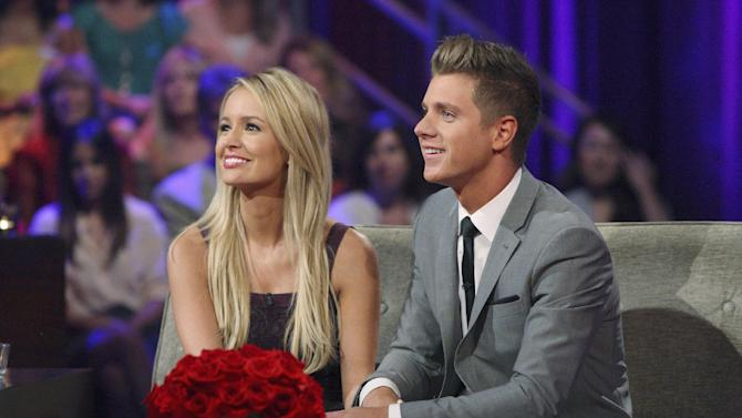 """This July 22, 2012 photo released by ABC shows Emily Maynard, left, and Jef Holm on """"The Bachelorette: After the Final Rose,"""" during a live broadcast in the Hollywood section of Los Angeles. Maynard selected Holm over Arie Luyendyk, Jr. on Sunday night's finale of the romance competition series. (AP Photo/ABC, Rick Rowell)"""