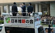 Osaka Mayor and co-leader of the Japan Restoration Party Toru Hashimoto (C) delivers a speech from a campaign car in Osaka, western Japan on December 4, 2012. Official campaigning for the December 16 lower house election kicked off on December 4.
