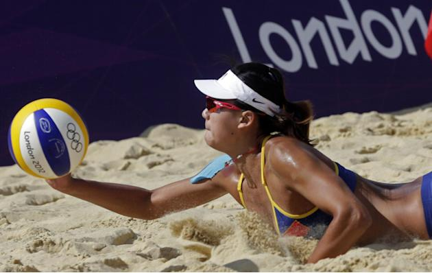 Xue Chen of China digs out a ball during a win over Switzerland during a beach volleyball match at the 2012 Summer Olympics, Monday, July 30, 2012, in London. (AP Photo/Dave Martin)