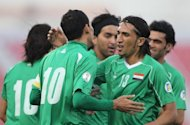 The Iraq national football team celebrate after scoring a goal during their Group A World Cup 2014 third-round Asian qualifying match against Singapore in February. Iraq will travel to Amman to face Jordan on Sunday