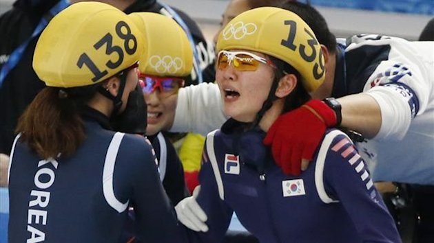 South Korea's Shim Suk Hee (R) reacts with Park Seung-Hi (L) after their team won the women's 3,000 metres relay final event at the Iceberg Skating Palace during the 2014 Sochi Winter Olympics February 18, 2014. REUTERS/Lucy Nicholson (RUSSIA - Tags: OLYM