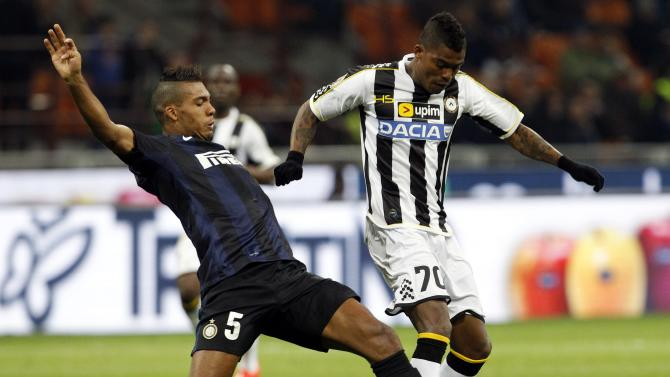 Inter Milan's Juan Jesus fights for the ball with Udinese's Maicosuel during their Italian Serie A soccer match in Milan