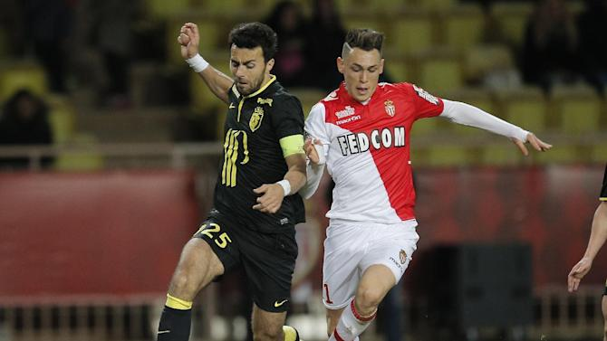 Monaco's Lucas Ocampos of Argentina, right, challenges for the ball with Lille's Marko Basa of Serbia during their French League One soccer match, in Monaco stadium, Sunday, March 23, 2014
