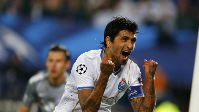 Porto's Gonzalez celebrates after scoring a goal against Austria Wien during their Champions League Group G soccer match in Vienna
