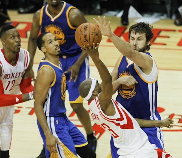 Corey Brewer of the Houston Rockets is blocked by Andrew Bogut of the Golden State Warriors during Game Three of the Western Conference Finals at Toyota Center on May 23, 2015 in Houston, Texas
