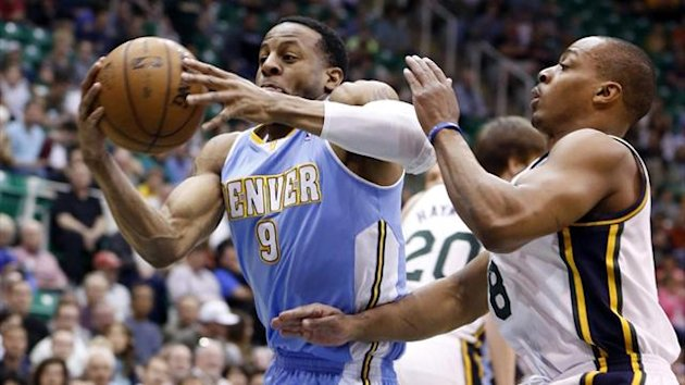 Denver Nuggets guard Andre Iguodala (9) drives past Utah Jazz guard Randy Foye (8) (Reuters)