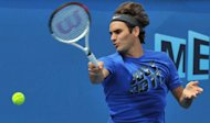 Roger Federer practises in Melbourne on January 12, 2013 ahead of the Australian Open. US legend John McEnroe warned Federer could struggle in the Melbourne heat as he bids for a fifth Australian Open crown, tipping younger rivals Novak Djokovic and Andy Murray
