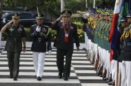 Chinese Defense Minister Liang Guanglie, center, salutes during arrival honors before meeting with his Philippine counterpart Voltaire Gazmin at the Defense Headquarters in suburban Quezon City, north of Manila, Philippines on Monday May 23, 2011. Guanglie's visit comes amid renewed tension over the disputed Spratly Islands, which are claimed by China, the Philippines and four other Asian countries and territories. Washington has expressed concerns that the disputes could hamper access to one of the world's busiest commercial sea lanes.