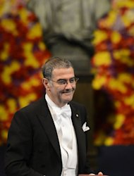 France's Serge Haroche, winner of the 2012 Nobel Prize in physics, reacts after he receives the award. The 2012 Nobel laureates in medicine, literature, economics, physics and chemistry received their prizes from Swedish King Carl XVI Gustaf at a gala ceremony in Stockholm on Monday