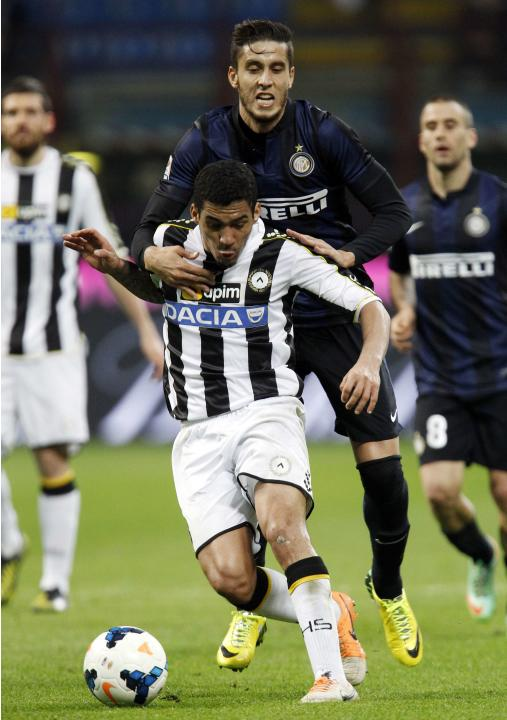 Inter Milan's Alvarez fights for the ball with Udinese's Allan during their Italian Serie A soccer match in Milan