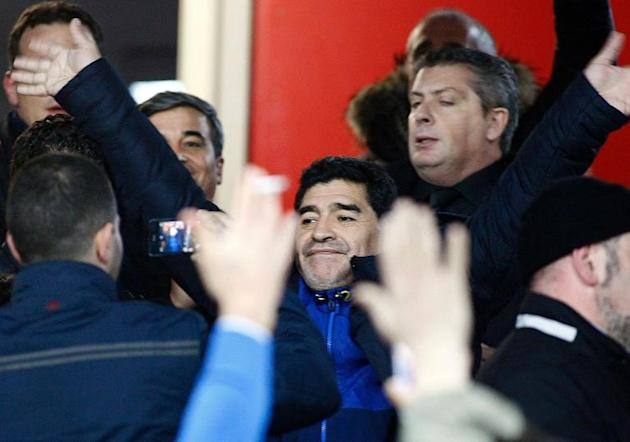 Former Argentine football player Diego Maradona (C) waves as he arrives at the Italian Cup semi-final second leg football match SSC Napoli vs AS Roma at the San Paolo Stadium in Naples, on February 12