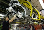 An employee of the Fiat Mirafiori plant works on the assembly line of the Nuova Punto cars in Turin, 2006. Fiat's boss painted a bleak picture of the Italian auto market but said the historic brand will stay in the country, amid union warnings that Italy's top private sector employer is set to shed jobs