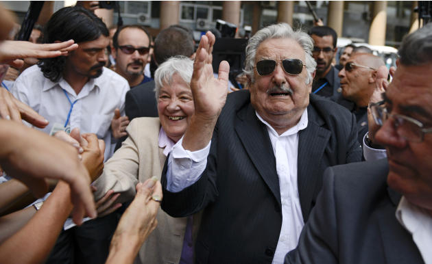 Uruguay's former President Jose Mujica and wife Lucia Topolansky greet supporters after the swearing-in ceremony for Uruguay's new President Tabare Vazquez at Independence Plaza in Montevideo,