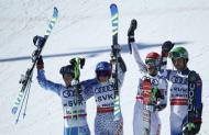 Alpine Skiing - FIS Alpine Skiing World Championships - Alpine Team Event - St. Moritz, Switzerland - 14/2/17 - (L to R) Slovakia's Andreas Zampa, Veronika Velez Zuzulova, Petra Vlhova and Matej Falat celebrate winning silver after the final of the parallel slalom Mixed Team event. REUTERS/Denis Balibouse