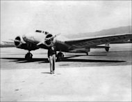 Undated picture taken in the 30's of American female aviator Amelia Earhart in front of her plane. A namesake and distant relative of Amelia Earhart is making plans for a symbolic recreation of the ill-starred 1937 flight around the world in which the pioneering aviatrix went missing