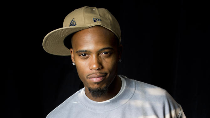 """In this April 30, 2012 photo, Atlanta-based recording artist B.o.B poses for a portrait in New York.  B.o.B released his sophomore album """"Strange Clouds,"""" on Tuesday. (AP Photo/Charles Sykes)"""