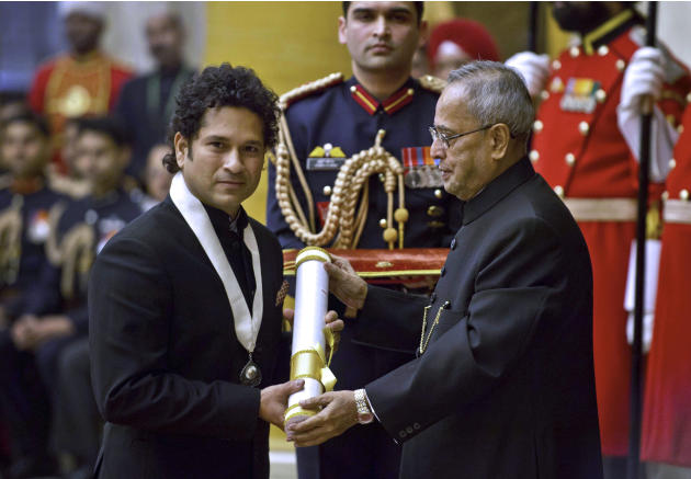 "India's cricket icon Sachin Tendulkar, left, receives the ""Bharat Ratna"" award from President Pranab Mukherjee during an awards ceremony at the Presidential Palace in New Delhi, India, T"