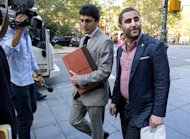 Charles Shrem, right, the top executive of a New York City-based Bitcoin company, walks from the federal court house in New York Thursday, Sept. 4, 2014, after pleading guilty to federal charges that he helped smooth the way for drug transactions on the online marketplace Silk Road. (AP Photo/Craig Ruttle)