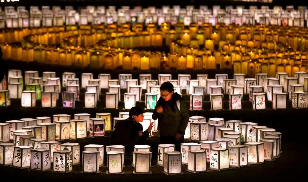 Thousands of lanterns are lit up to mourn for the victims of March 11, 2011 earthquake and tsunami in Natori, Miyagi Prefecture