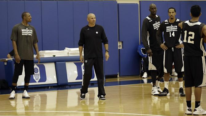 Brooklyn Nets' coach Jason Kidd, second from left, works with players during NBA basketball training camp at Duke University in Durham, N.C., Tuesday, Oct. 1, 2013