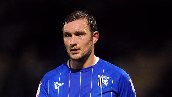 Danny Kedwell's penalty proved enough to give leaders Gillingham all three points
