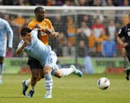 Manchester City's Argentinian Sergio Aguero (L) vies with Wolverhampton Wanderers' Cameroon player Sebastien Bassong during an English Premier League football match between Wolverhampton Wanderers and Manchester City at Molineux Stadium in Wolverhampton. Manchester City won 2-0