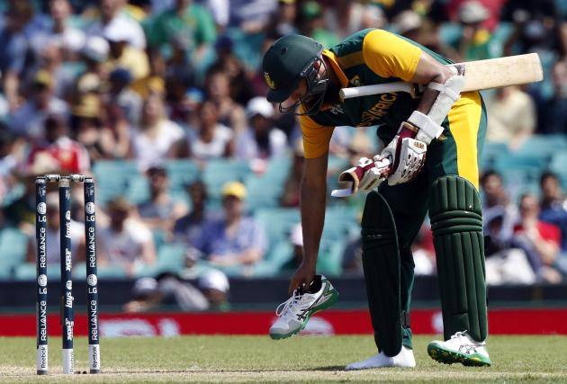 South Africa's Amla puts his shoe back on after it came off while he was running during the Cricket World Cup match against the West Indies at the SCG