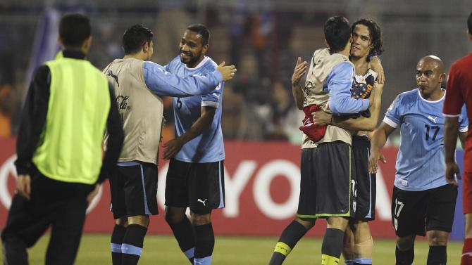 Uruguay's Edinson Cavani and team mates celebrate after defeating Jordan in their World Cup qualifying playoff first leg soccer match at Amman International stadium