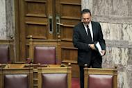 Greece's new Finance Minister Yiannis Sturnaras arrives at the Greek parliament in Athens. Greek Prime Minister Antonis Samaras on Friday asked EU-IMF creditors for more time for a tough bailout programme, to ease the pain on an economy struggling in its fifth year of recession