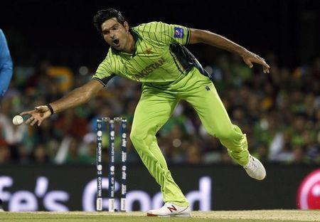 Pakistan's Mohammad Irfan stretches to field a ball during the Cricket World Cup match against Zimbabwe at the Gabba in Brisbane
