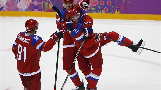 Ice Hockey - Russia reach quarters; Latvia shock Switzerland
