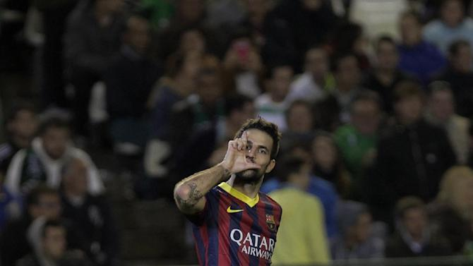 Barcelona's Francesc Fabregas celebrates after scoring against Betis during their La Liga soccer match at the Benito Villamarin stadium, in Seville, Spain, Sunday, Nov 10, 2013