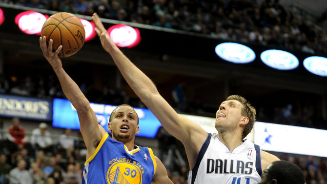 Golden State Warriors point guard Stephen Curry (30) drives to the basket on Dallas Mavericks power forward Dirk Nowitzki (41) in the second half during an NBA basketball game on Wednesday, Nov. 27, 2013 in Dallas. The Dallas Mavericks won 103-99