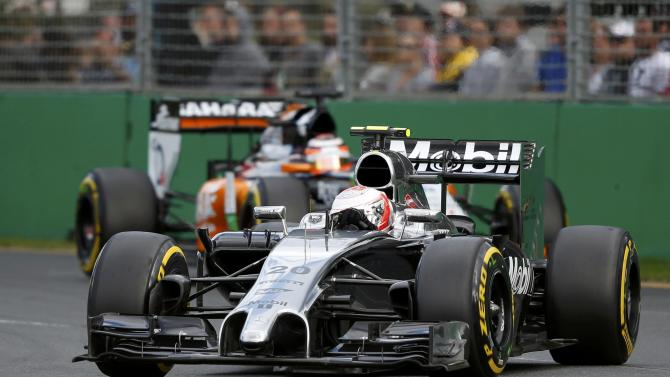 McLaren Formula One driver Magnussen of Denmark drives ahead of Force India Formula One driver Hulkenberg of Germany during the Australian F1 Grand Prix in Melbourne