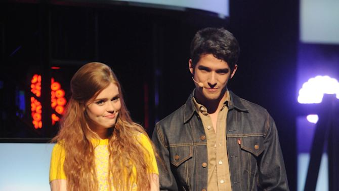 "IMAGE DISTRIBUTED FOR MTV - From left, Holland Roden and Tyler Posey introduce ""Teen Wolf"" at the 2013 MTV Upfront, on Thursday, April 25, 2013 at the Beacon Theater in New York. (Photo by Brad Barket/Invision for MTV/AP Images)"