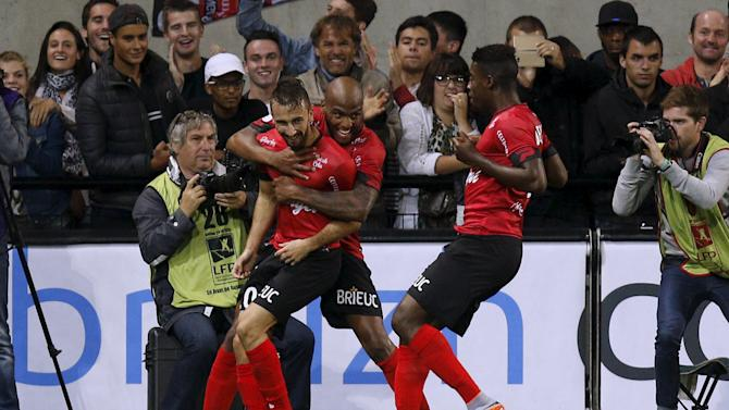 Guingamp's Benezet celebrates with teammates after scoring a goal against Olympique Marseille during their French Ligue 1 soccer match at the Roudourou stadium in Guingamp