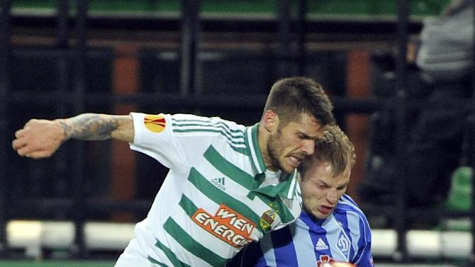 Rapid's Christopher Trimmel, left, and Kiev's Oleh Gusev challenge for the ball, during their Europa League second round group G soccer match between SK Rapid Wien and FC Dynamo Kiev, in Vienna, Austria, Thursday, Oct. 3, 2013
