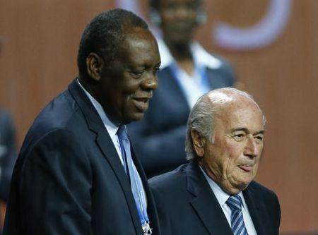 Hayatou, Senior Vice President of the FIFA stands with FIFA President Blatter after he was re-elected at the 65th FIFA Congress in Zurich
