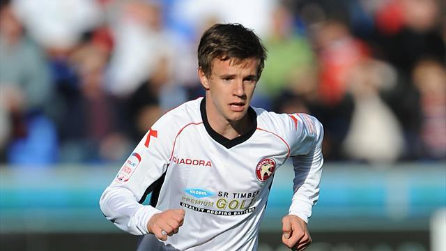 League One - Baxendale pens new deal at Walsall