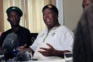 Expelled ANC Youth League president Julius Malema addresses a press conference on September 18. South Africa's police issued an arrest warrant for firebrand Julius Malema whose calls for a wave of illegal mining strikes have inflamed a spread of crippling shut-downs on mines