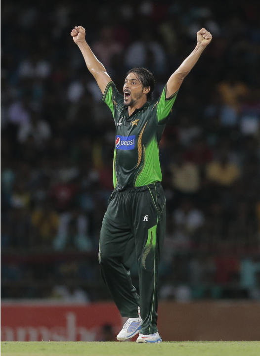 Pakistani bowler Anwar Ali celebrates taking the wicket of Sri Lankan batsman Thisara Perera during the first Twenty20 cricket match between Sri Lanka and Pakistan in Colombo, Sri Lanka,Thursday, July