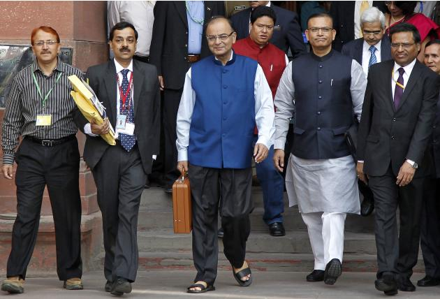 India's Finance Minister Arun Jaitley (C) leaves his office to present the 2015/16 federal budget in New Delhi