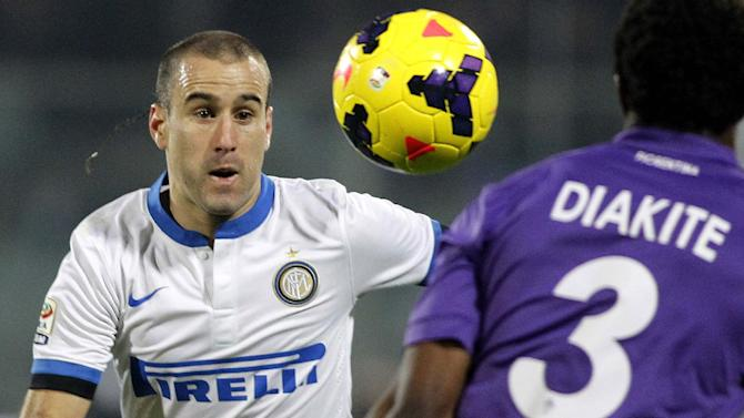Inter Milan's Rodrigo Palacio, left, vies for the ball with Fiorentina's Modibo Diakite during a Serie A soccer match between Fiorentina and Inter Milan, at the Artemio Franchi stadium in Florence, Italy, Saturday, Feb. 15, 2014