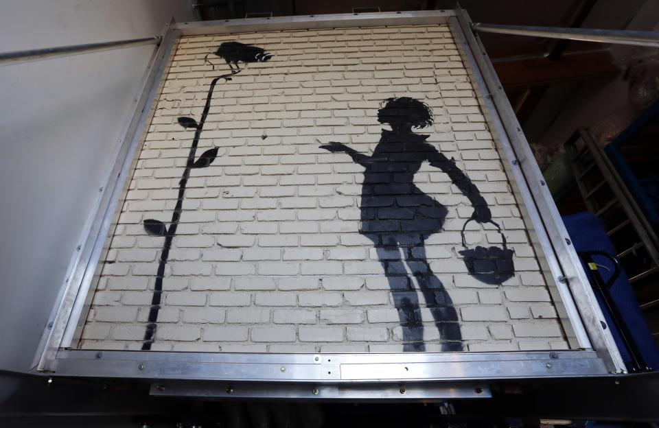 Banksy mural fetches 209k at california auction the for Banksy mural sold