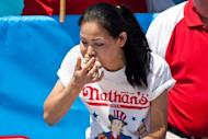 Competitive eater Sonya Thomas competes in the Nathan's Famous International Hot Dog Eating Contest at Coney Island. More than a million customers in the storm-hit United States remained without power Wednesday, as canceled firework displays and no air-conditioning made for a miserable July 4 holiday for many Americans