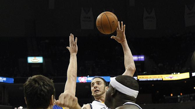 Memphis Grizzlies center Kosta Koufos, back, shoots against Golden State in the second half of an NBA basketball game Saturday, Dec. 7, 2013, in Memphis, Tenn. Golden State won 108-82