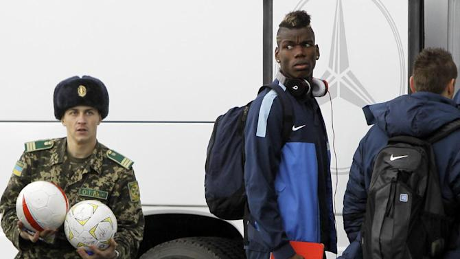 France's national soccer team player Paul Pogba arrives at the Kiev airport ahead of their 2014 World Cup qualifying play off first leg soccer match against Ukraine  in Kiev, Ukraine, Thursday, Nov. 14, 2013