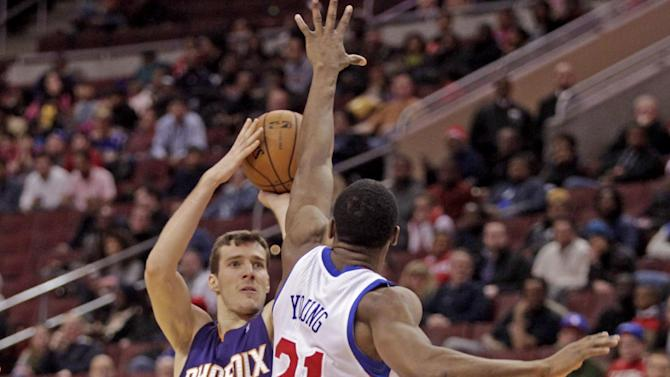 Phoenix Suns' Goran Dragic (1) goes up for a shot as Philadelphia 76ers' Thaddeus Young (21) defends in the first half of an NBA basketball game, Monday, Jan. 27, 2014 in Philadelphia