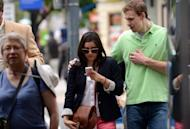 A woman uses her smartphone while crossing street in Washington, DC, on May 9. More smartphones means more Americans are using the devices to get location information or to share their whereabouts with friends, a study showed Friday