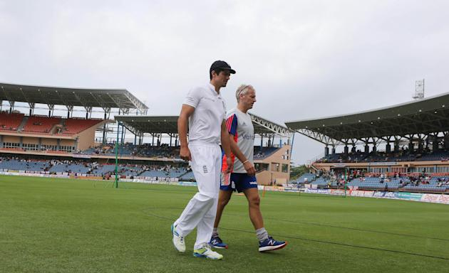 Cricket: England's Alastair Cook and Head Coach Peter Moores as rain delays the start of play